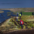 People hiking near Hengifoss on Iceland — Stockfoto