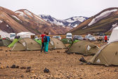 Couple walking across a camping site on Iceland — Stock Photo
