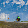 Stock Photo: Two people cycling through Iceland