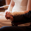 Bridal couple holding hands — Stock Photo