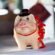 Piggybank with ribbon — Stock Photo