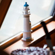 Miniature lighthouse with cake — Stock Photo