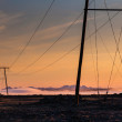 Mountains at sunrise with electric and telephone cables (Iceland — Photo #37745483