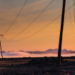 Стоковое фото: Mountains at sunrise with electric and telephone cables (Iceland