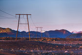 Mountains at sunrise with electric and telephone cables (Iceland — Stock fotografie