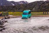Car crosses a river in Iceland — Stock Photo