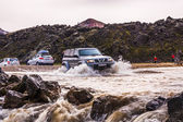 SUV crosses a river in Iceland — Stock Photo