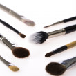 Stock Photo: Selection of makeup brushes over white background