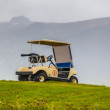 Foto Stock: Small cart or buggy parked on hilltop