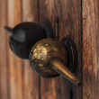 Interesting metal door handle with twin spheres — Stock Photo