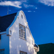 Stock Photo: Whitewashed gable on double story building