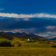 Stock Photo: Quaint rural church in rolling hills in Iceland