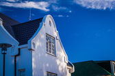 Whitewashed gable on a double story building — Stock Photo