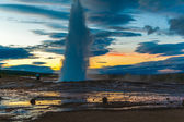Erupting geyser Strokkur shooting up a column of steam — Stock Photo