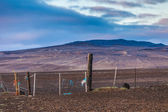 Old broken down dilapidated fence in Iceland — Stock fotografie