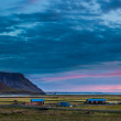 Farm buildings at sunset in Iceland — Stock Photo #39242219
