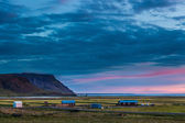 Farm buildings at sunset in Iceland — Stock Photo