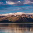 Snowy mountains with blue sky on a lake in Iceland — Foto Stock