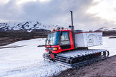 All terrain vehicle with continuous tracks in snow — Stock Photo
