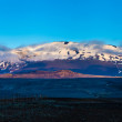 Snow-capped volcanic mountain peak in Iceland — Stok fotoğraf #40226343