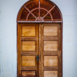 Old arched wooden double door — Stock Photo