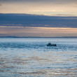 Fishing boat on the ocean at dawn or sunset — Stock Photo