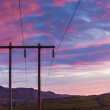 Stock Photo: Electricity pylon against spectacular sunset