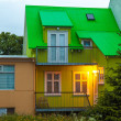 Brightly lit building on a street in Reykjavik — Stock Photo #40321335