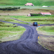 Road leading to a rural farm in Iceland — Stok fotoğraf