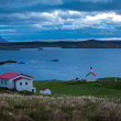 Stock Photo: House overlooking sheltered bay in Iceland