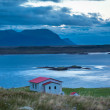 Foto Stock: House overlooking sheltered bay in Iceland