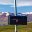 Stock Photo: Metal postbox on a pole in Iceland