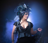 Beautiful young woman with fairytale headdress — Stock Photo