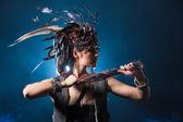 Young amazon with fairytale headdress — Stock Photo