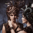 Two beautiful young woman with fairytale headdress — Stock Photo