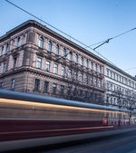 Old town with passing streetcar — Stock Photo