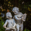 Statue of Two Boys Talking — Stock Photo