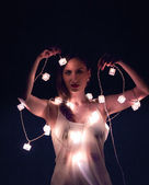 Sexy girl with christmas lights — Stock Photo