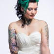 Young bride with tattoos — Stock Photo #48765841