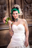 Bride in front of a church — Stock Photo