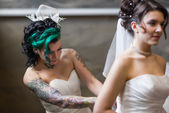 Two brides dressing up — Stock Photo