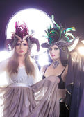 Beautiful women with fairytale headdress — Stock Photo