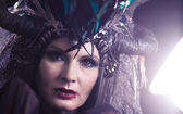 Beautiful woman with fairytale headdress — Stock Photo