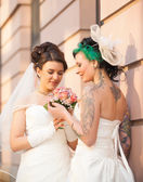 Two brides in love — Stockfoto