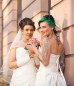 Two brides in love — ストック写真