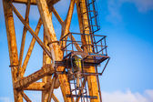 Worker climbing up a crane — Foto de Stock
