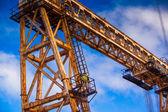 Worker climbing up a crane — Stock Photo