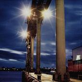 Floodlights on a harbor — Stock Photo