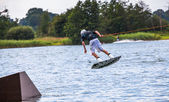Surfs on a wakeboard — Stok fotoğraf