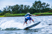 Man surfs on a wakeboard — Foto Stock
